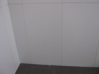 The shower after it's had the render repaired and new wall tiles